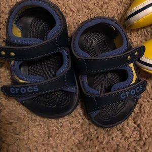 Like new blue baby crocs sandals with size defect